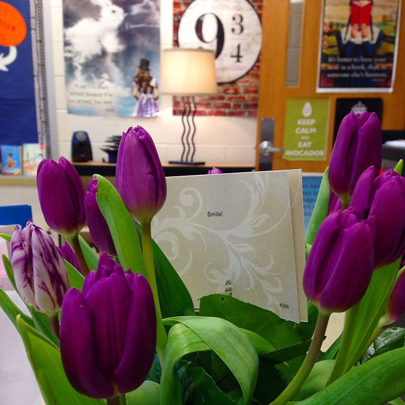 Scott surprised Al with her favorite flowers (purple tulips!) at school.